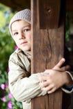 Cute boy behind a pillar royalty free stock photography
