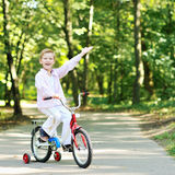 Cute boy with bicycle smiling Stock Photography