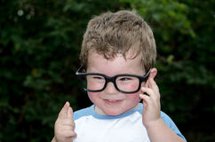 Cute boy with big glasses Royalty Free Stock Photos