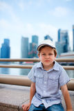 Cute boy in big modern city Royalty Free Stock Images