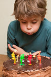 Cute boy at birthday cake Stock Photography
