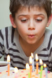 Cute boy at birthday cake Stock Image
