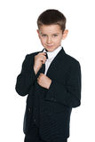Cute boy in the black suit Royalty Free Stock Photo
