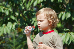 Cute boy blowing a bubbles outdoors on a sunny day Stock Photography