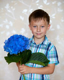 Cute boy with blue flowers Royalty Free Stock Photo