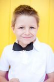 Cute boy with bow tie party accessory Royalty Free Stock Photos