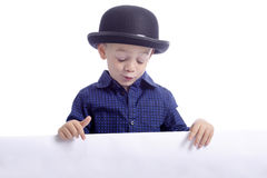 Cute boy with bowler hat and ad space Royalty Free Stock Photos