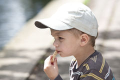 Cute boy with bread Royalty Free Stock Image