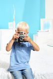 Cute boy with a camera Stock Image