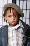 Cute boy in a cap Stock Photos
