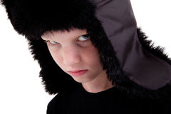 Cute boy with a cap, bored Stock Photo