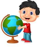 Cute boy cartoon looking at globe Stock Images