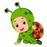 Cute boy cartoon wearing snail costume Royalty Free Stock Image