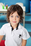 Cute Boy In Casuals At Kindergarten Stock Photo