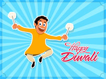 Cute boy celebrating Happy Diwali festival. Cute boy playing with firecrackers, celebrating and enjoying on occasion of Indian Festival, Happy Diwali Royalty Free Stock Photography