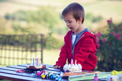 Cute boy, celebrating his birthday outdoor. Summertime Stock Photo