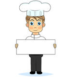 Cute boy chef holding a blank sign Stock Photo