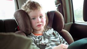 Cute boy in a child car seat Royalty Free Stock Image