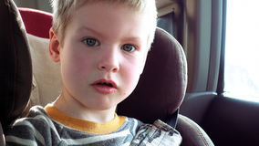 Cute boy in a child car seat Royalty Free Stock Photo