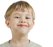 Cute boy with chocolate face Royalty Free Stock Image