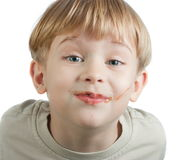 Cute boy with chocolate face Stock Image