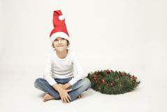 Cute boy with christmas cap Royalty Free Stock Images