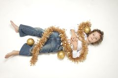 Cute boy with Christmas decorations Royalty Free Stock Image