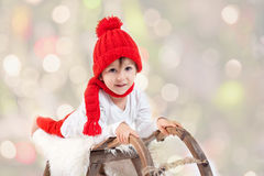 Cute boy on christmas, having fun with snowman Royalty Free Stock Photography