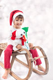 Cute boy on christmas, having fun with snowman Stock Photography