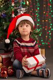 Cute boy with Christmas present Royalty Free Stock Image