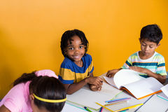 Cute boy with classmates Royalty Free Stock Photo