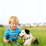 Cute boy with collie stock images