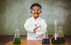 Cute boy with conical flasks in classroom Royalty Free Stock Images