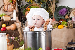Cute boy in a cook pan Royalty Free Stock Images