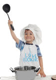 Cute boy is cooking Stock Photo