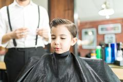 Cute Boy After Haircut In Barber Shop stock photos