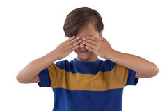 Cute boy covering his eyes Royalty Free Stock Images