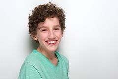 Cute boy with curly hair smiling Stock Photography