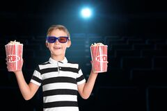 Boy in 3D glasses with popcorn buckets in cinema, space for text