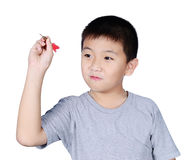 Cute boy with dart isolated on white background Stock Photography