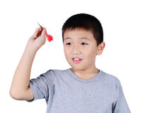Cute boy with dart isolated on white background stock images