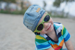 Cute boy in denim hat and sunglasses Stock Images