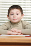 Cute boy at desk Royalty Free Stock Images