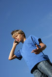 Cute boy discussing on his cell phone Royalty Free Stock Images