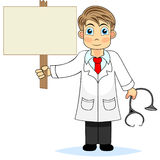 Cute boy doctor holding a blank wooden sign Royalty Free Stock Image