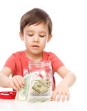 Cute boy with dollars Royalty Free Stock Photo
