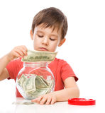 Cute boy with dollars Royalty Free Stock Photography