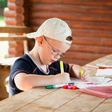 Cute boy drawing Stock Photography