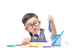 Cute boy drawing with colorful crayons Stock Photos
