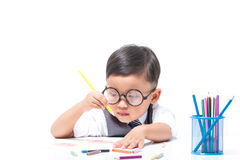 Cute boy drawing with colorful crayons Stock Photo